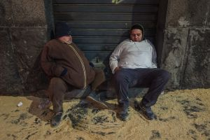Groggily sleeping men at Festa Sant'Agata  in Catania