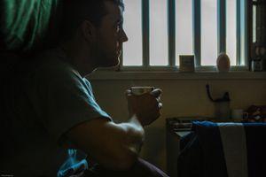 A enhanced prisoner sitting in his cell. HMP/YOI Portland, Dorset