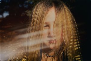 Girl With the Braids Series - Light in the Woods