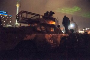 Police advancing with armoured vehicle through Independence Square, February 2014.
