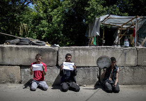 Locals suspected in looting arrested by rebels at a checkpoint near the city of Luhansk