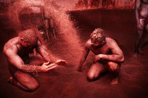 Kushti - Pehlwans (wrestlers) covering their body with red clay, Pune