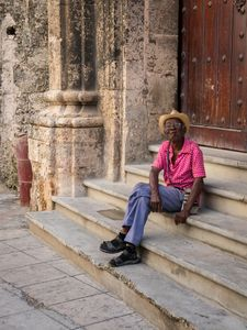 Man with Cigar on Cathedral Steps, Havana, Cuba