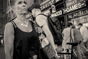 Woman walking along Mass. Ave in Cambridge, MA