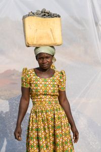 Lakot  Night: Works in quarry breaking stones to make gravel.  Earns 1,000 shillings ($0.32) per Jerrycan of gravel. Makes 10 Jerrycans of gravel per day.