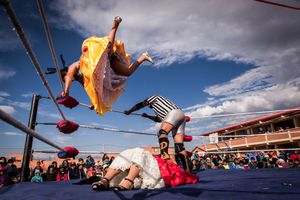 Silvina La Poderosa jumps from a corner of the ring to land in her opponent, Reyna Torres, during a fight in Senkata.