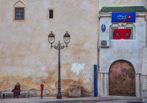 Woman on bench, El Rcif Square, Fes, Morocco, 2015.