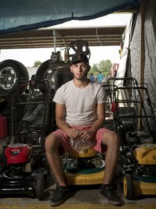 Mike Omerovic is Bosnian and works in his father's small engine repair business, Tony's Tools. They have a space in the Pendergrass Flea Market in Pendergrass, GA in addition to a shop in Lawrenceville, GA. Mike is a senior in high school and wants to open his own repair shop as soon as he graduates, but he hasn't decided whether to do it in Bosnia or the US. © Forest McMullin