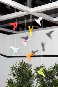 paper birds ( recorded bird sounds are playing in various places in IKEA's showrooms