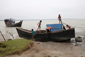 Children plying on a fishing boat at Patharghata in Barguna district in Bangladesh