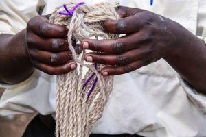 Man Holds Up Hand-Spun Yarn, Musanze Rwanda Africa