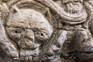 Detail of grotesque figure on the font at St. Lawrence, Castle Rising
