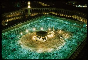 """Pilgrims circle the Kaaba in Mecca, Saudi Arabia.  Making this time exposure from the roof of his nearby hotel, Abercrombie watched the faithful, dressed anonymously in white, circle the Kaaba """"in harmony with the planets and the atoms,"""" he wrote. Saudi Arabia, 1965 © Thomas J. Abercrombie, National Geographic"""