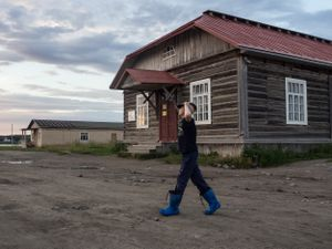 A boy in front of the museum of the GULAG prison in Solovetsky Islands.