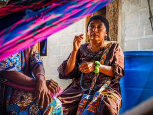 Some families have exchanged traditional building materials for concrete. Traditionally, the walls are made out of yotojoro—a wattle and daub of mud, hay and dried canes, but today some Wayuu have shifted towards a more modern construction style, using cement and other materials.