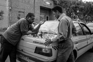 Taxidrivers playing chess on the back of their car
