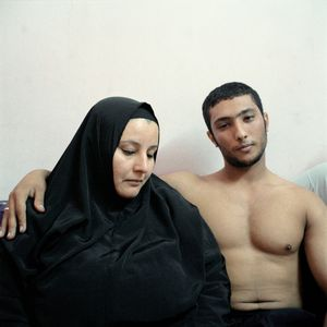 2nd Prize People – Staged Portraits Stories. Ali, a young Egyptian bodybuilder, poses with his mother © Denis Dailleux, France, Agence Vu