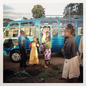 A school bus drops pupils back at their homes in Kibera. The Kibera slum is the largest slum in Nairobi with around half a million inhabitants.