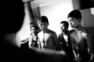 Boys are waiting for the upcoming boxing match.  © Sandra Hoyn