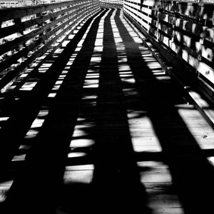Shadows on a Wooden Bridge