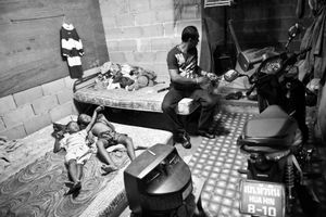 The bedroom of the boxing coach and his two sons. © Sandra Hoyn