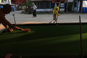 People play Billiard as their leisure and for small amount of money sometime at Yuzana Garden City, Yangon, Myanmar.