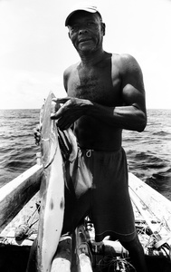 Zanzibari spear fisher displays a predatory fish attracted by the blood from his previous catches