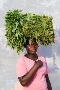 A. Kevine; Sells Seed Potato leaves.6 for 1,000 shillings. Earns about 10,000 shillings ($3.00) per day.