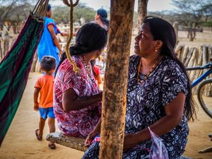 Luz Marino, the informal leader of her local Wayuu tribe. The Wayuu are a matriarchal people, so it is Luz who owns the rancheria where the family lives. She is also one of the few older Wayuu who can bridge the two worlds by speaking both Wayuunaiki and Spanish.