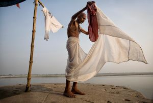 Varanasi, India: The man alongside the holy Ganges is getting ready for the funeral of his relative, who will be cremated on the most sacred Hindu place. © Matjaz Krivic