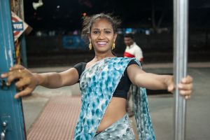 a young hijra who I met on a train in Mumbai - She was dancing and hoping to bless passengers, in exchange for a few rupees.  © Alison McCauley