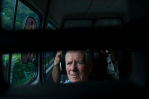Mr Giuseppe Melotto, 85 years old, looks out the van's window during a day trip on summertime.