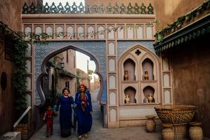 Resident walks in the renovating neighborhood area in old Kashgar, Xinjiang Uighur Autonomous Region, China.