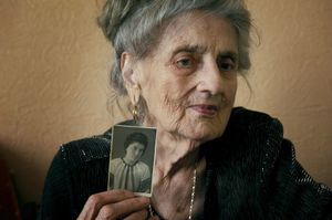 """Anna Vasilievna Bigus, 88, spent ten years of her youth in the Gulag. At age 19, she was separated from her family and sent into the Arctic Circle. """"The only joy we could have in Gulag was singing. We sang a lot. And this gave us the strength to survive…"""" Her daughter became a music teacher and her grandchildren sing in opera. © Elena Chernyshova"""