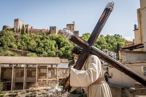 The Moorish Alhambra fort serves as dramatic backdrop for the processions in Granada, Spain.