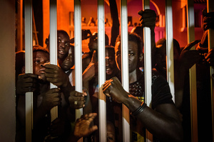 Fans try glimpse inside the house of the Lac de Guiers 2 after the wrestler´s victory over Yekini on July 24 2016.