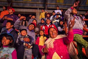 The Bolivian public cheers the cholitas during a fight in the 12th October Sports Complex in the city of El Alto. To many people in town going to see the fights of the Cholitas is their favorite past time.