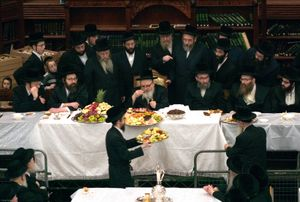 The Orthodox Jewish festival of Tu Bishvat is celebrated as the New Year of trees with a symbolic eating of different varieties of fruit. Here in a Stamford Hill synagogue the Chassidic Skver Rebbe visiting from New York blesses the fruits in front of the entire synagogue.
