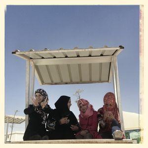 Nour*, Samar*, Jana* & Hiba* sat outside in the multiactivity centre area in Za'atari refugee camp.