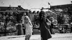 Girls playing with bubbles
