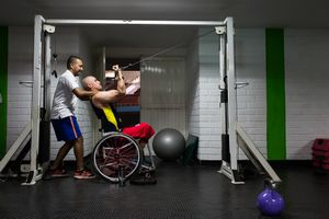 Oscar Rios, 42, does exercises with the help of his fitness coach on the Envigado Gymnasium, Medellin, March, 2016.