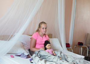 Youngest daughter styles her doll. Manitoba, Canada 2014