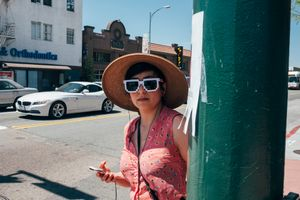 A young lady wearing pixel sunglasses. North Park, San Diego