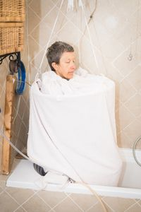 Luisa, 50 years old, pictured in her bathroom where she built a self-made sauna to clean herself from toxins.