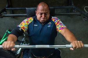 Joe Gonzalez Bettencourt, 38, lifts weight during a gym session at Atanasio Girardot Stadium, Medellin, March 2016.