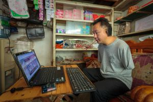 A community based rehabilitation programme has helped Li learn how to order stock, using a pen in his mouth or between his toes to operate a computer.