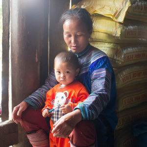Hmong flower mother and son