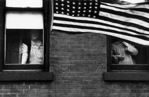 """Parade, Hoboken, New Jersey, 1955. From """"The Americans."""" © Robert Frank. Published by Robert Delpire, then Grove Press, and most recently reprinted by Steidl."""