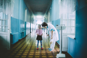 The girl is crying in front of people with TB injections. Tsurupinsk children's TB hospital, September 2011.