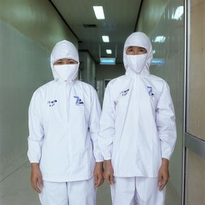 Bui Truong Tci and Phani Thi Thanh Canh, Prawn factory, Nha Trek, Vietnam.